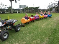 this is a image of kids in a Barrel Train